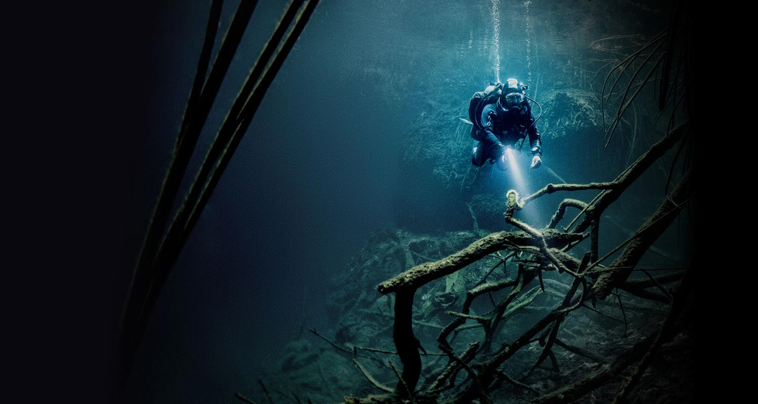 Forensic Trace Metaphor: Deep sea diver shines light on sea bed - Taking tracing solutions to new depths